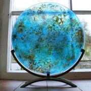Gaia, fused glass disc, forged steel stand