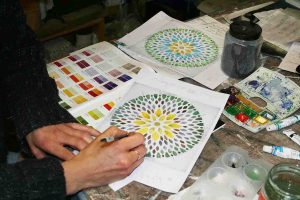 artist painting glass bowl design