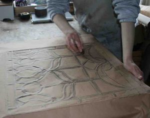 making a rubbing of a damaged stained glass window