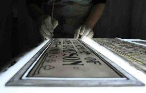 reproducing badly damaged memorial plaque